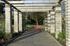 Pergola and woodland view Royalty Free Stock Image