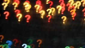 Perguntas demais Textura abstrata do fundo das luzes sob a forma dos pontos de interrogação vídeos de arquivo