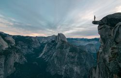Perhaps The Best View Of Glacier Point Where This Unknown Adventurer Dares To Stand On The Edge Stock Photography