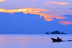 Magical sunset - Malaysia. Sunset and boat in The Perhentian Islands in Malaysia in south east asia royalty free stock photography