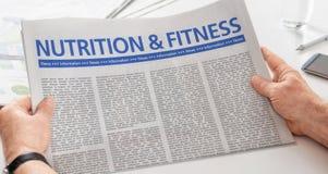 Periódico con la nutrición y la aptitud del título fotografía de archivo