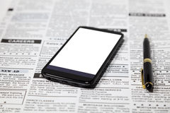 Periódico y smartphone falsos Fotografía de archivo