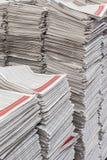 Periódicos en pilas altas Imágenes de archivo libres de regalías