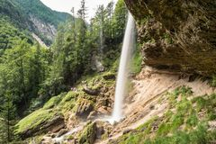Pericnik Waterfall Slap Pericnik in Triglav National Park, Slovenia with hiking path behind the waterfall royalty free stock images