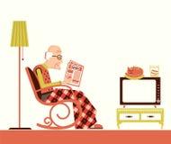 Periódico de la sentada y de la lectura del viejo hombre Foto de archivo