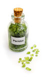 Peridot gem stones in bottle Royalty Free Stock Image
