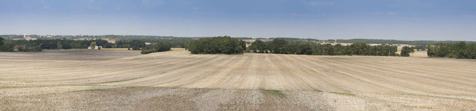 Perigord Panorama. Panorama showing recently harvested field in the Perigord region of Sothern France stock photography