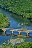 Perigord, the picturesque bridge of Castelnaud in Dordogne Royalty Free Stock Image