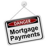 Perigos de ter a prestação de hipoteca Imagens de Stock Royalty Free