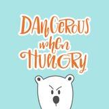 Perigoso quando ilustração com fome da rotulação do desenho da mão com o urso branco dos desenhos animados Boa frase para o t-shi ilustração royalty free