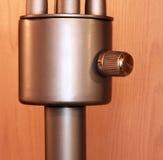 Perilla con estrías en el poste del metal Imagen de archivo