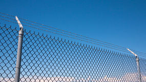 Perimeter fence. With barbed wire and chain link Stock Images