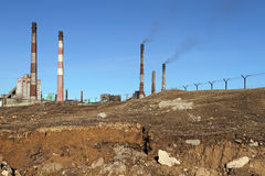 The perimeter of the plant is surrounded by barbed wire for prot. Ection. Protection of the plant with smoking chimneys Royalty Free Stock Photography