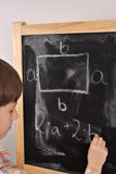 The perimeter of the rectangle. Student by the blackboard Royalty Free Stock Photo