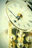 Period clock with oscillating mechanism Stock Images