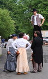 Period Costumes and Stilts Stock Image
