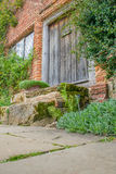 Period oak plank door in red brick house Royalty Free Stock Image
