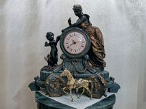 A beautiful antique clock showing the time of the day. stock photo