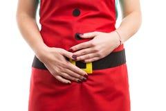 Periode of menstrueel pijngebaar met handen op lagere buika Stock Foto