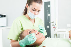 Periodic dental care in dentist office Royalty Free Stock Images