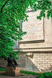 Periodic table of the chemical elements ans statue of Dmitri Men. SAINT PETERSBURG, RUSSIA - MAY 27, 2015: Periodic table of the chemical elements on the wall Stock Image