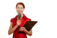 Periodista con el micrófono Imagen de archivo libre de regalías