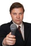 Periodista con el micrófono Imagenes de archivo