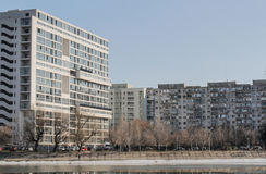 Periphery landscape. Bucharest, Romania, 7 February 2016: Landscape with tall residential blocks and lake in a Bucharest suburb royalty free stock image