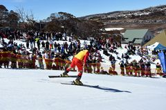 People enjoy Pond Skimming, a fun way to celebrate the end of the winter season. Perisher, Australia - Sept 30, 2018. People enjoy Pond Skimming. The pond-skim stock images