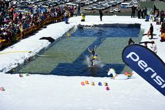 People enjoy Pond Skimming, a fun way to celebrate the end of the winter season. Perisher, Australia - Sept 30, 2018. People enjoy Pond Skimming. The pond-skim stock photography