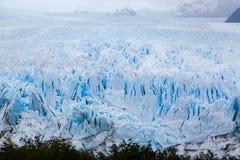 Perito Moreno Glacier Argentina. The front of Perito Moreno glacier in Patagonia, the mass of blueish ice flowing into argentino lake Stock Image
