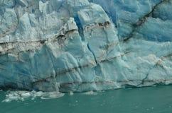 Perito Moreno Glacier Ice Breaking. Perito Moreno Glacier Piece of Ice starting to fall to the lake Stock Photography