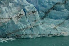 Perito Moreno Glacier Ice Breaking. Perito Moreno Glacier Piece of Ice starting to fall to the lake Royalty Free Stock Image