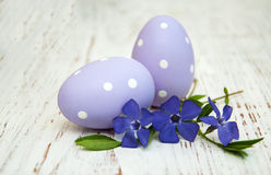 Periwinkle and easter eggs Stock Photos
