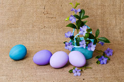 Periwinkles in basket with easter eggs Royalty Free Stock Photography