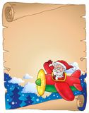 Perkament met Santa Claus in vliegtuig Stock Foto's