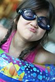 Perky Lips of Summer. Five year old girl making a silly face while wearing goggles and swimsuit. Colorful picture Royalty Free Stock Photography