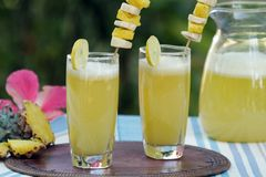 Perky pineapple a super delicious summer drink. A tangy, tasty and extremely refreshing drink which is packed with full of nutrients and it is one of the great Royalty Free Stock Images