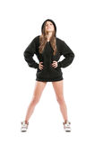Perky and sexy female wearing a black hoodie. Standing isolated on white background Royalty Free Stock Photography