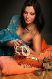 Perl. Beautiful indian woman laying in ethnic interior Stock Photography
