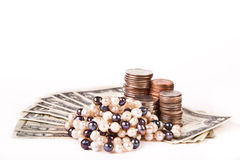Perl jewellery with dollars and cents Stock Photography