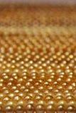 Perla de oro hermosa Imagen de archivo libre de regalías