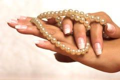 Perla y mano Fotografía de archivo libre de regalías