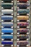 Perlas coloreadas en tubos Fotos de archivo libres de regalías