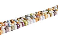 Perlas coloridas Fotos de archivo libres de regalías