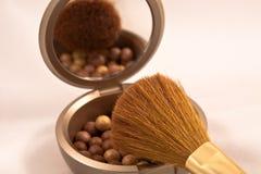 Perlas de bronce del maquillaje Imagen de archivo