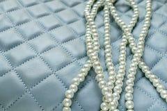 Perlas en el fondo de cuero Imagen de archivo libre de regalías