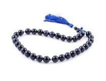 Perle blu scuro del rosario, dalla gemma Fotografia Stock