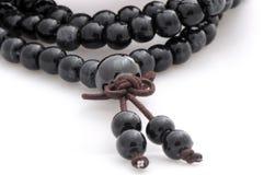 Perle di preghiera buddisti di pietra nere Fotografie Stock Libere da Diritti