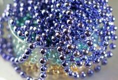 Perle di vetro lilla come fondo astratto Immagini Stock Libere da Diritti